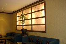 Custom millwork framing for backlighted window feature in Hotel lounge.