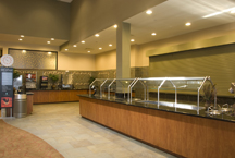Granite countertops and wood counters for hotel cafeteria's food serving areas.