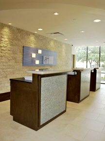Hotel Registration Counters constructed in wood, granite and mosaic tile present a stylish, professional yet comfortable greeting for hotel guests.
