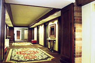 Guest floor elevator lobby remodeling in 'world class' hotel features fine craftsmanship in paneling and molding renovations.