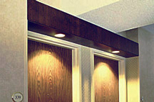 Special wood crafted guest room entrance headers were custom built to hold recessed lighting and add distinctive ambience for hotel guests.