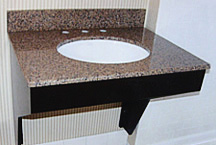 Custom designed and constructed 'special needs' vanity with cut-away base and granite countertop for hotel's 'special needs' guests.